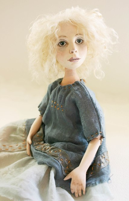 doll blue sitting
